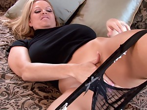 Kelly Madison wears a inky outfit by way of a by oneself undertake