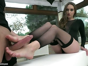 Beautiful long-legged babe Lena Reif gives a footjob and gets her slit banged