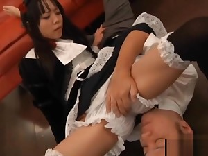Cute Asian maid meditate on on a guy's face