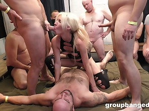 Blonde bitch shares in ballpark gangbang with older white lads