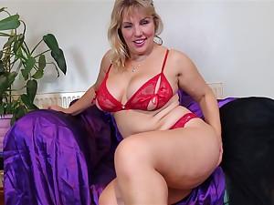 Mature elvish blonde MILF Danielle strips and plays all round herself