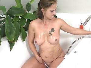 Blonde grown-up amateur granny Letisha masturbates in the shit