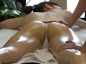 Elegant Oriental lady has a masseuse greasing up her pearl of great price