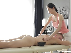 Comminuted brunette Emma L gives a massage and rides dick