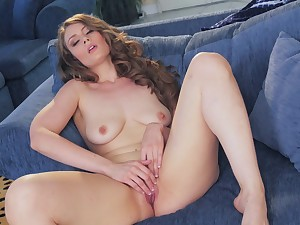 Adorable brunette babe Jenna Justice pleasures her cunt on the bed