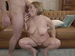 Blonde MILF with big tits enjoying hardcore coitus